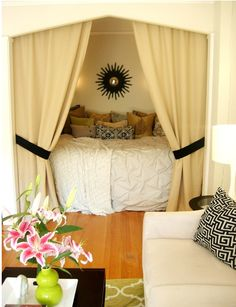 Tucking the bed into the closet or alcove so you have a full usable space! Love this!
