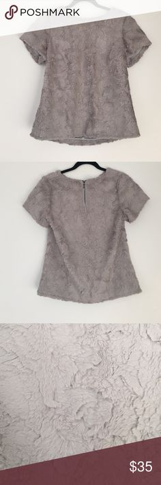 Anthropologie grey faux fur top Gray faux fur too. In great condition. Worn only a handful of times. It keeps you pretty warm. Very soft fabric. Anthropologie Tops Blouses