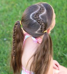 Swim hair.  A wavy cornrow into two ponytails, with one regular braid in the…