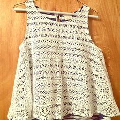 Strip tank with lace overlay Striped tank with lace overlay, loose fit. Excellent condition! Love it, just doesn't fit right anymore. Anthropologie Tops Tank Tops