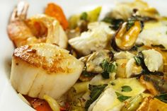 Ligurian Seafood Stew with a Basil Saffron Cream Sauce - Chef Dennis Ligurian Seafood Stew: Restaurant style dinners you can make at home for less than half the price! Shrimp Stew, Seafood Stew, Fish And Seafood, Fish Dishes, Seafood Dishes, Fish Recipes, Seafood Recipes, Cioppino Recipe, Pasta
