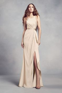 Charmeuse and chiffon come together on this White by Vera Wang bridesmaid dress, creating a sophisticated silhouette with a flattering halter neckline, waistline gathering, and a ruffled skirt slit.