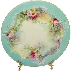 Offered for sale is this gorgeous, porcelain plate produced by Jean Pouyat of Limoges, France. Hand painted and signed by E.R. Stillman, it features