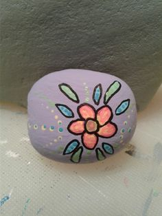 Flower, dots, rock painting