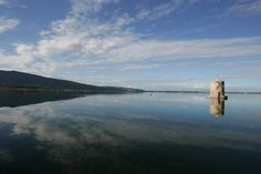 The Lagoon of Orbetello, in the back the Promontory of Argentario and the ancient wind mill. Photograph by Andrea de Maria.