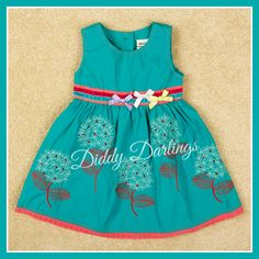 Teal summer dress with lots of pretty detail. Excellent quality. The dandelions have little sequins sewn in. It really is a beautiful dress. Size 12-18, 18-24 months, 2-3, 3-4 and 4-5 years. £15.99 with free UK delivery www.facebook.com/DiddyDarlings1 www.diddydarlings.co.uk
