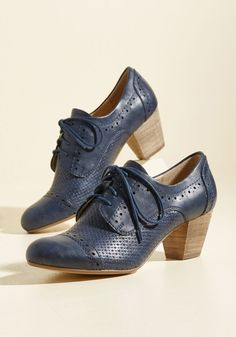 Just when you started to believe nothing could improve your stay in Italia, you slipped into these faux-leather heels. Suddenly, your prosecco is bubblier and the sights that much lovelier, thanks to the rich navy hue, embossed details, and wood-inspired stacked heels of this perforated pair. Bravo to that!
