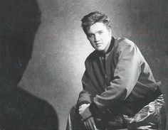 Elvis wearing the pants from his gold lamé suit and his red sweater with black collar and black sleeve cuffs in this photo that was likely taken backstage at the Maple Leaf Gardens in Toronto, Canada on Tuesday, April 2, 1957.