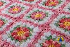 Cute afghan. Pattern is in Portuguese, but google translate does okay. The video is poor quality, but between that and google translate for the written pattern, it should be easy to figure out. Note that she is using a double ended crochet hook.