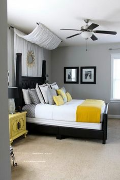 Re-doing my bedroom like this we have black bed and white comforter with yellow accents to complent our yellow on suite...but those night stands <3