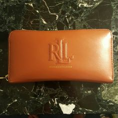 Ralph Lauren Leather Wallet Barely used, in great condition beautiful leather wallet.  Elegant gold zipperin. Can be used as just a clutch as well. Ralph Lauren Bags Wallets