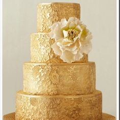 Gold wedding cake! If I did a black, white, and gold theme this would be a contender for the cake but maybe no flower or a different flower..