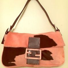 Authentic LN- FENDI PINK/BLK pony hair hobo Extremely beautiful and of course supersoft pony hair hobo bag this bag is absolutely amazing it predates 2006 but it is in like new/EUC condition.. Yes she comes with her own dust bag has silver hardware adjustable strap made of lush chocolate leather snap front closure typical Fendi design pony hair has a light amount of gentle where but you will be amazed whenever you see this bag!! Ships within one business day. Has a couple spots on dust bag…