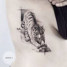 black and gray tiger tattoo by @goldy_z
