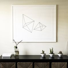Here's one of our most popular prints is this geometric prism wall art - perfect for any modern home, and paired with simple decor like succulents or cacti plants.