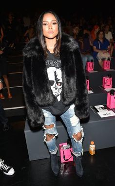 Karrueche Tran sits in the front row of the Betsey Johnson show for Spring/Summer 2016 at New York Fashion Week on Sept. 11, 2015.