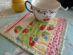 Quilted Strawberry Applique Mug Rug Snack Mat. Would be nice made out of vintage tablecloth fabric.