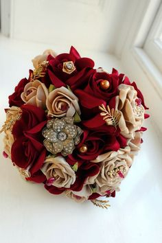 Beautiful red and gold wedding bouquet with jewels!