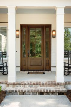 Over 25 years building award-winning custom homes throughout the South Carolina Lowcountry. Wood Front Doors, Exterior Front Doors, Front Door Decor, Entry Doors, Entryway, House Front Door, House Doors, Farmhouse Front Porches, Front Porch Design