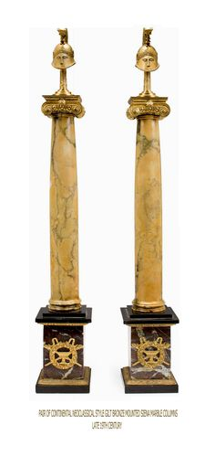 A pair of Continental Neoclassical style gilt bronze mounted Siena marble columns late 19th century. Each surmounted by an Etruscan style helmet, the pedestal in rosso levanto and black marble - Dim: height 31 1/4in (79.5cm).