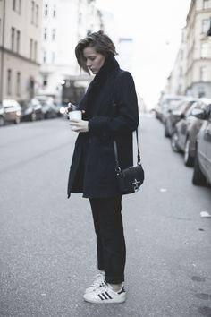 Emma Svensson | Coat (Filippa K). Trousers (Acne Studios). Sweater (Soft goat). Bag (Givenchy). Sneakers (Adidas).