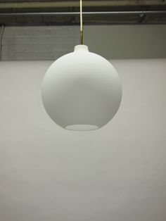 Vilhelm Wohlert; Opal Glass and Brass Ceiling Light for Louis Poulsen, 1959.