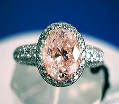This 2.21-carat diamond appeared on Ebay on June 30th, 2003. The seller, ucdealshere, wanted $58,000 for the opening bid. The stone is actually Light Pink, not quite Fancy Light Pink, even though it appears more saturated