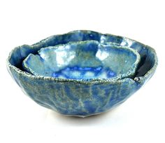 This set of two rustic blue stoneware nesting bowls are handmade using the pinching method giving them a unique organic feel mirroring the makers mark - the direct finger prints of the maker! They feature a beautiful fused glass base in blue, and are ideal as salt and pepper cellars or for dukkah and a range of condiments including olives, jam & cream, soy sauce, wasabi, pickled ginger. mustard, tomato sauce, rock salt, dip, pate, the list goes on! Equally they can be used as ring holders...