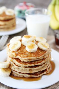 Banana Pancakes Recipe on twopeasandtheirpod.com Light, fluffy pancakes that will remind you of banana bread! They are easy to make and freeze beautifully too!