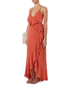 Exclusive for Intermix Barletta Silk Maxi Dress: Coral: Strappy cross back with a crossover ruffled V front. Self tie sash. Hi/lo hem. Lined. In coral. Fabric: 100% silk Lining: 100% polyester Made in China. Model Measurements: Height 5'8.5 ; Waist 24 ; Bust 33 wearing size S Length from shoulder to hem: ...