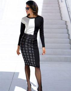 98% laine verge de mérinos, 2% fil métallisé. Lavable en machine. Longueur jupe env. 62 cm.