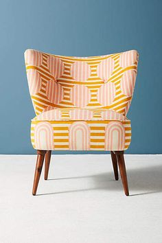 Whether it's wedding blankets from Morocco or Suzanis from Uzbekistan, textiles have been used to symbolize a sense of place for centuries. #orange #chair #orangechair #chairs #funkychair #afflnk