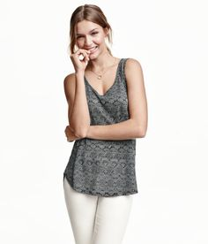 Check this out! CONSCIOUS. Oversized tank top in jersey with a printed pattern. Pleat at back and rounded hem. Slightly longer at back. Made partly from recycled polyester. - Visit hm.com to see more.