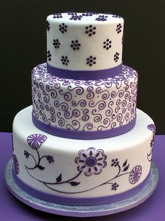 wedding cake - I like the middle tier but what if the colors were different shades of purple and orange/peach