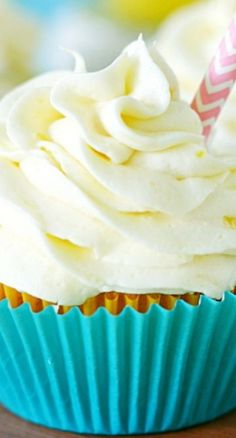 Pineapple Dole Whip Cupcakes: Filled with Fresh Pineapple Curd and Frosted with Tart Pineapple Frosting. A Disney inspired Tropical Treat.