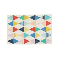 Shop Colorful Triangle Rug.  We called this flatweave cotton rug our Colorful Triangle Rug for three reasons.  One: It's colorful.  Two: It has triangles.  And three: It's a rug.  In retrospect, we probably didn't need to specify that.