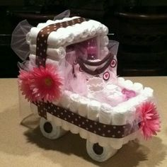 Well I've mastered the Tiered Diaper Cake. let's try a Baby carriage diaper cake. Baby Shower Crafts, Baby Shower Parties, Shower Gifts, Baby Shower Themes, Baby Shower Decorations, Shower Ideas, Diy Diaper Cake, Nappy Cakes, Diaper Cake For Girls