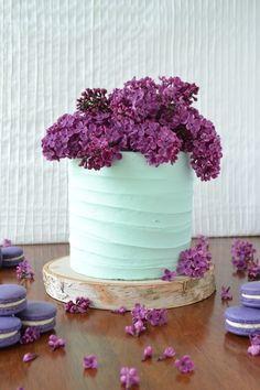 Mint colored Cake with Lilacs and Purple pastry cream filled Macarons by Cassidy Budge Cake Design