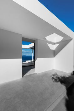 Stark white walls frame vistas of the Ionian Sea from a bright white house by Brussels-based architect Olivier Dwek