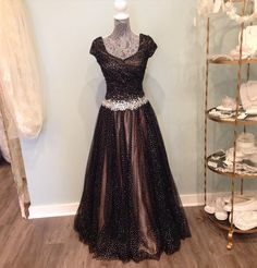 A lovely black sparkly tulle ballgown with rich champagne undertone.