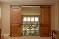 Could we put barn doors on our loft?  Then when kids (or other guests) are up there, they could close off noise from great room.
