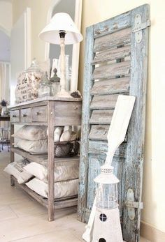 vintage shutter decor leaning on wall...love the rustic beach house decor