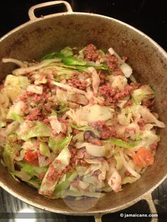 "Corn Beef and Cabbage which is also known as Bully Beef and Cabbage is one of those ""lazy"" one-pot Jamaican meals that is cooked when you are on the go. It is said to be a favorite of single men because of how easy it is to cook. Please be aware that the corn beef mentioned in this recipe is not the sliced corn beef that is typically seen in sandwich delis outside of the Caribbean but it is from a can.  Jamaica and much of the English Speaking Caribbean call it bully-beef.  Enjoy our…"