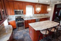 white granite honey maple cabinets