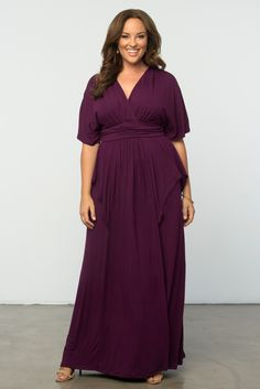 Our indie Flair Maxi Dress in Boysenberry will be a favorite in your closet for summer. This gorgeous dress has a draped feature in the front that flatters your curves. The sleeves are roomy and flow for added comfort. Wear this fabulous dress to your next outdoor wedding! Made in the USA. www.kiyonna.com