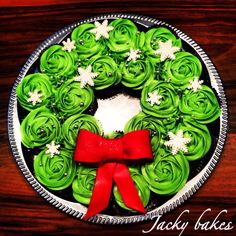 CHRISTmas idea. Cupcakes on a Round Tray,shaped like Wreath. Add Bow.