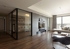 This clever example of interior layout, by the team at Fertility Design, experiments with the introduction of retractable glass doors within the heart of a home