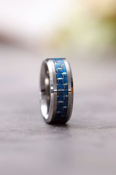 This silver and blue tungsten carbide wedding ring, inlaid with white and grey carbon fiber, has a comfortable beveled edge that does not cause finger allergies. Stacked Wedding Rings, Wedding Rings For Women, Wedding Ring Bands, Rings For Men, Trendy Wedding, Mens Ring Designs, Wedding Ring Designs, Tungsten Engagement Rings, Tungsten Carbide
