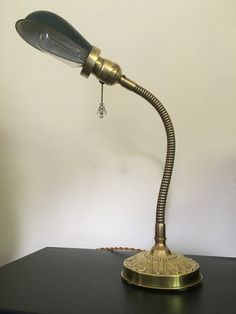 Early 20th century Faries brass gooseneck task lamp with Hubbell shade and Edison bulb.