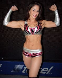 Sarah Stock (Dark Angel - Sarita) was released by TNA in early 2013 and has gone back to being a full time luchadora for CMLL. She is also incredibly ripped now.